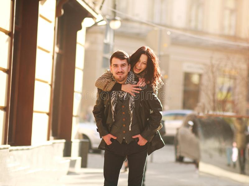 Romantic happy young couple in love in tourist city having fun stock image