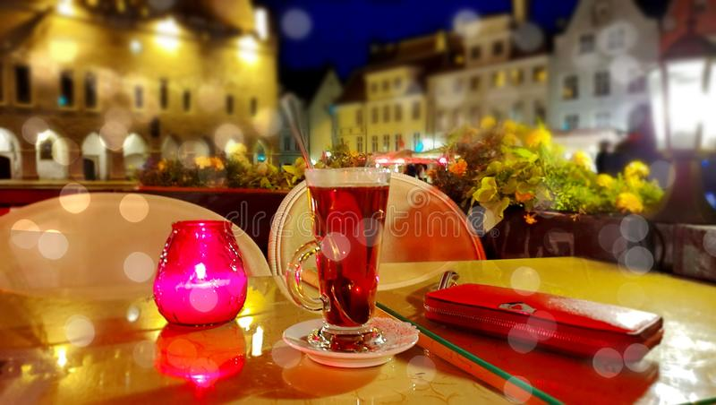 Romantic holiday city light Street cafe  bokeh blurring city light evening restaurant table cup of coffee on top view candle lamp. Romantic holiday  city light royalty free stock photo