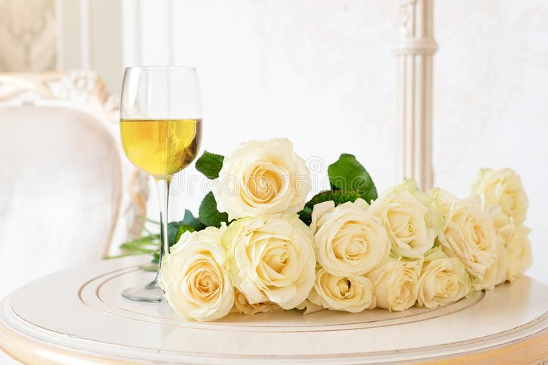 Romantic holiday composition with wine glass and roses for Valentines Day. Love, gift and spring holiday background. stock images