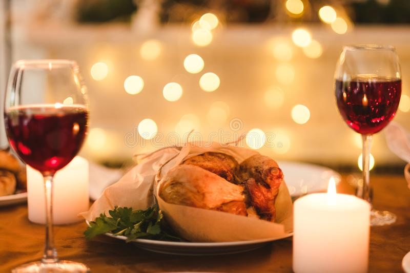 Romantic homemade evening family dinner. Concept. kitchen traditions. delicious holidays food and bright lights stock photo