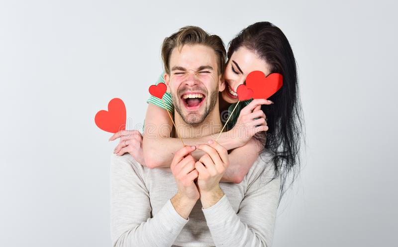 Romantic ideas celebrate valentines day. Man and woman couple in love hug and hold red heart valentines cards close up stock photography
