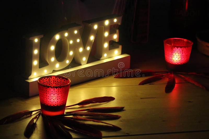 Romantic image with candles and the word love bright royalty free stock photography