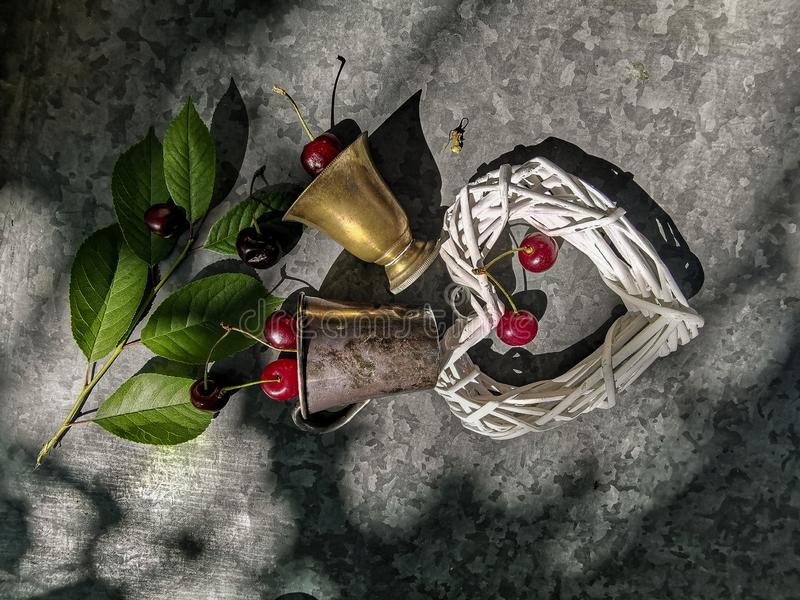 The romantic image of the heart and copper glass with a cherry royalty free stock photography