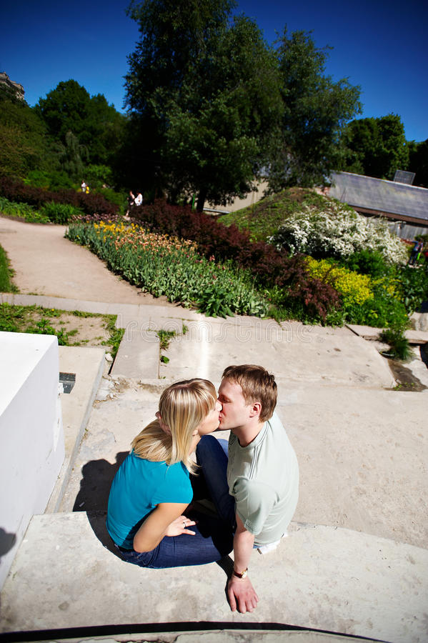 Romantic kiss. Happy couple in park royalty free stock photo