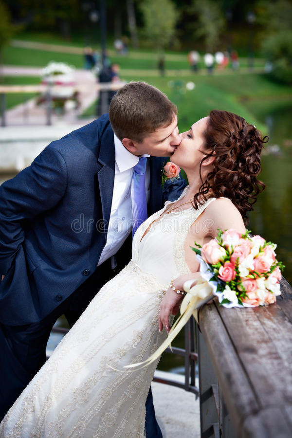 Romantic Kiss Bride And Groom Stock Photo - Image of walk, brunette ...