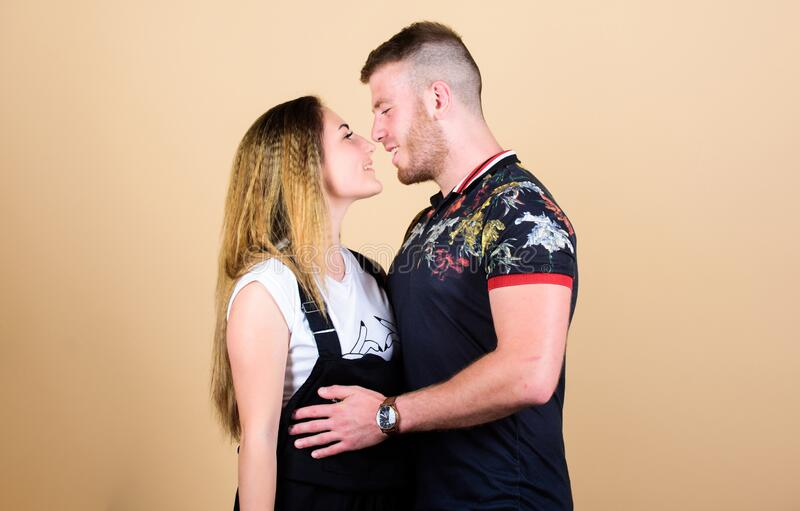 Romantic kiss. Cute and sweet relationship is dream for every girl in world. Couple in love. Couple goals concept. Man. And women beige background. Family love stock images