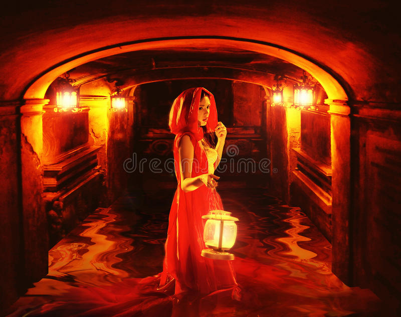 Download Romantic Lady In Red Holding A Lantern In A Dark Dungeon Stock Photo - Image: 29778226