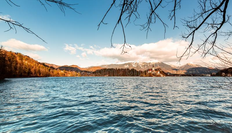 Romantic landscape at Lake Bled in Slovenia. Winter scenery sunny day, view of the church in the middle of the lake. Panorama royalty free stock image