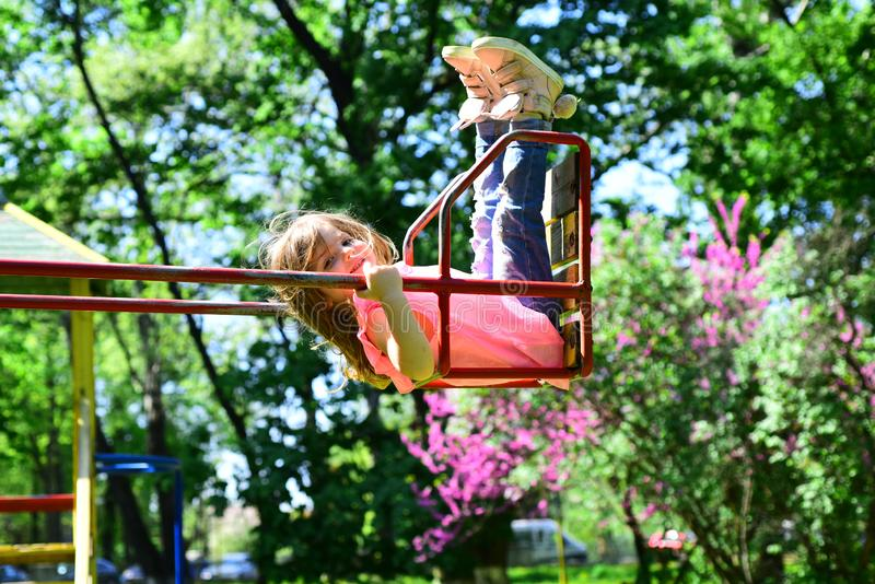 Romantic little girl on the swing, sweet dreams. Small kid playing in summer. childhood daydream .teen freedom royalty free stock photos
