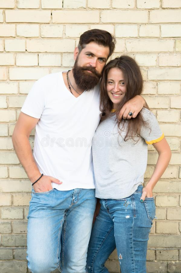 Romantic love. Bearded man hugging pretty woman with love. Erotic love of brutal hipster and sexy woman. Sensual couple royalty free stock images