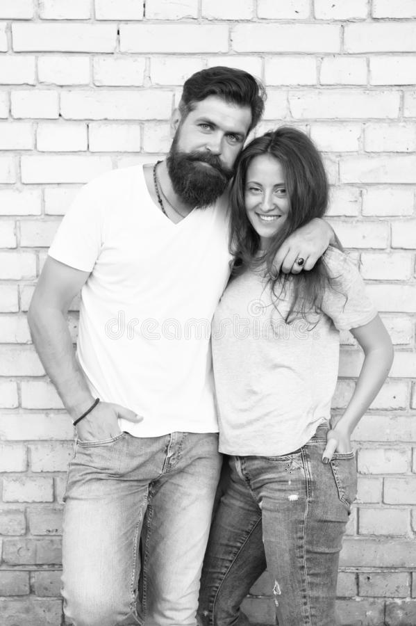 Romantic love. Bearded man hugging pretty woman with love. Erotic love of brutal hipster and sexy woman. Sensual couple stock images