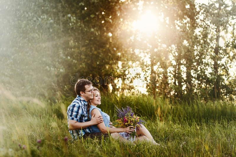 Romantic love story in the Woods at sunset stock images