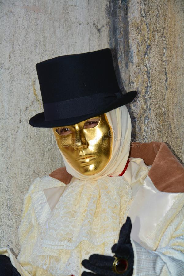 Romantic male golden mask in Venice, Italy, Europe royalty free stock image