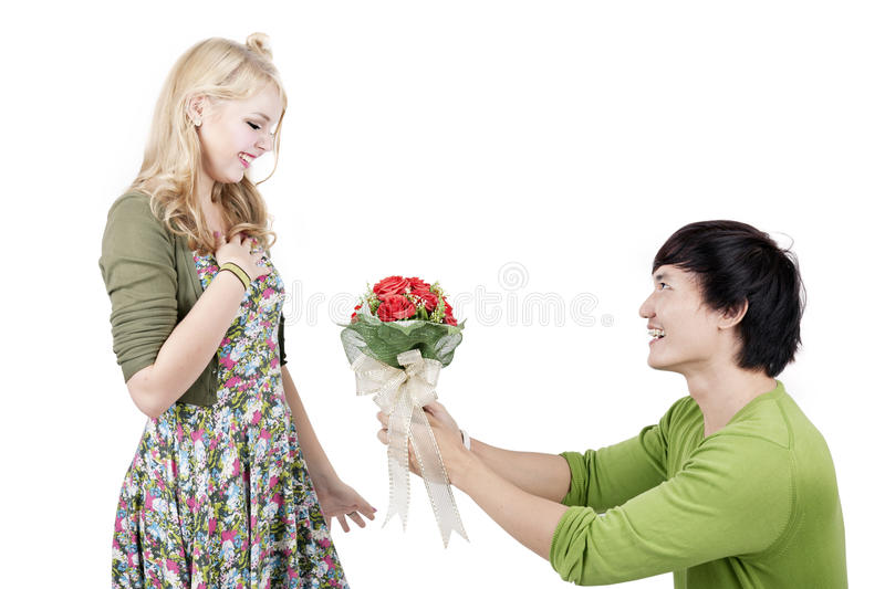Download Romantic Man Giving Flowers Stock Photo - Image: 25508964