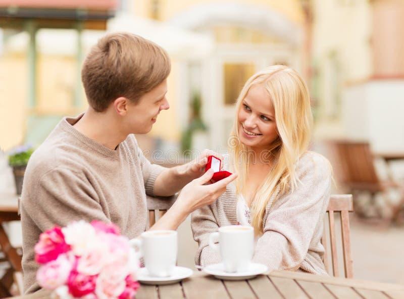 Romantic man proposing to beautiful woman royalty free stock photos