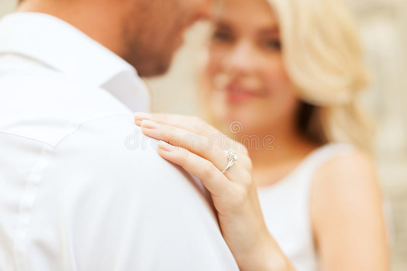 Romantic man proposing to beautiful woman. Summer holidays, love, travel, tourism, relationship and dating concept - romantic men proposing to beautiful woman royalty free stock photos