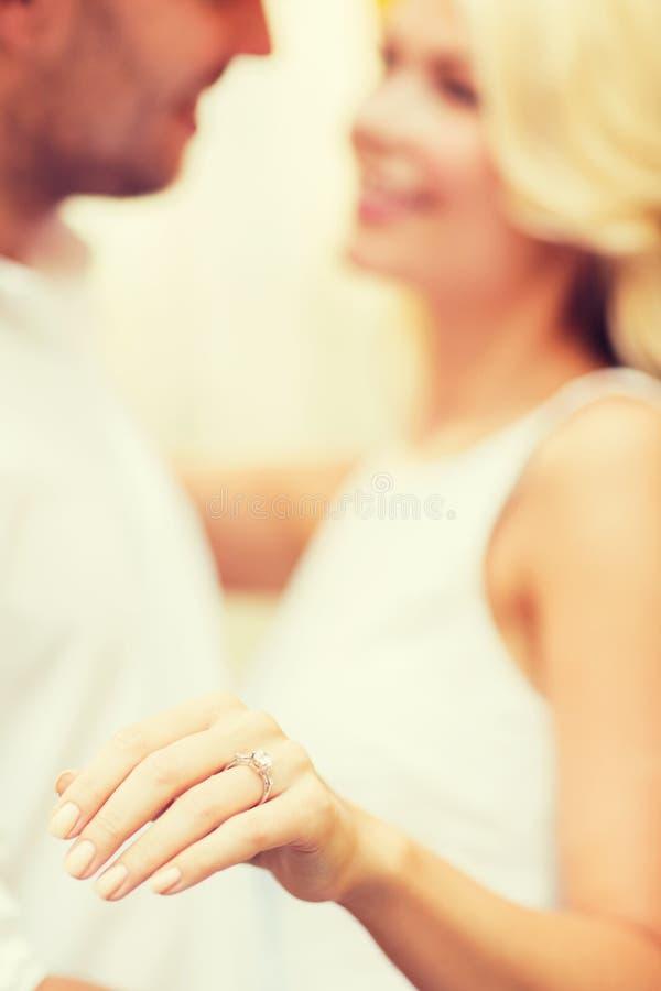 Romantic man proposing to beautiful woman royalty free stock photo