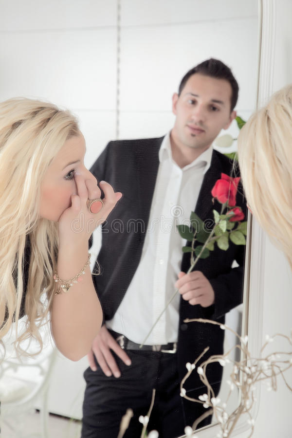 Romantic man watching his sweetheart stock images