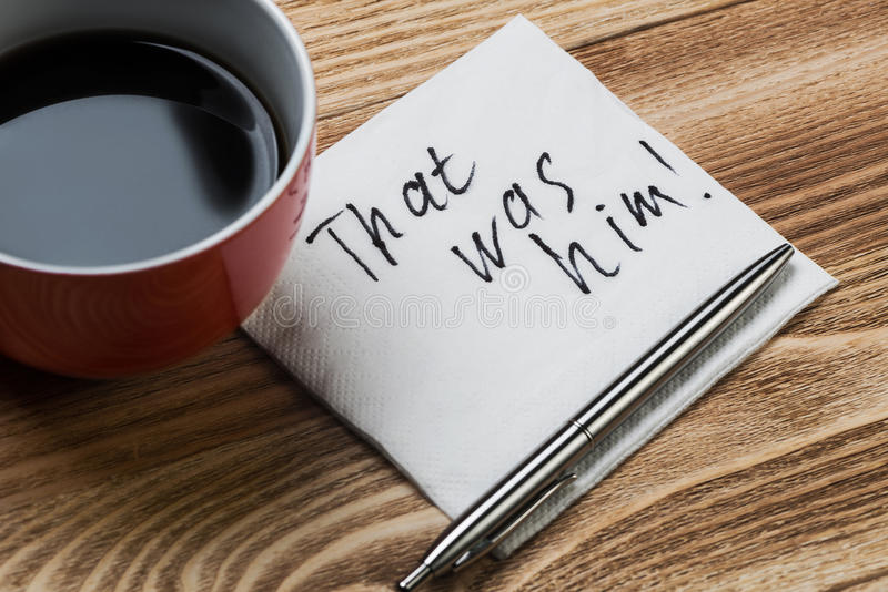 Romantic message written on napkin. Coffee cup pen and napkin with words on wooden table stock photo