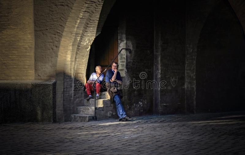 A romantic moment editorials. A tourist couple enjoying a romantic moment after roaming around the city for a whole day royalty free stock images
