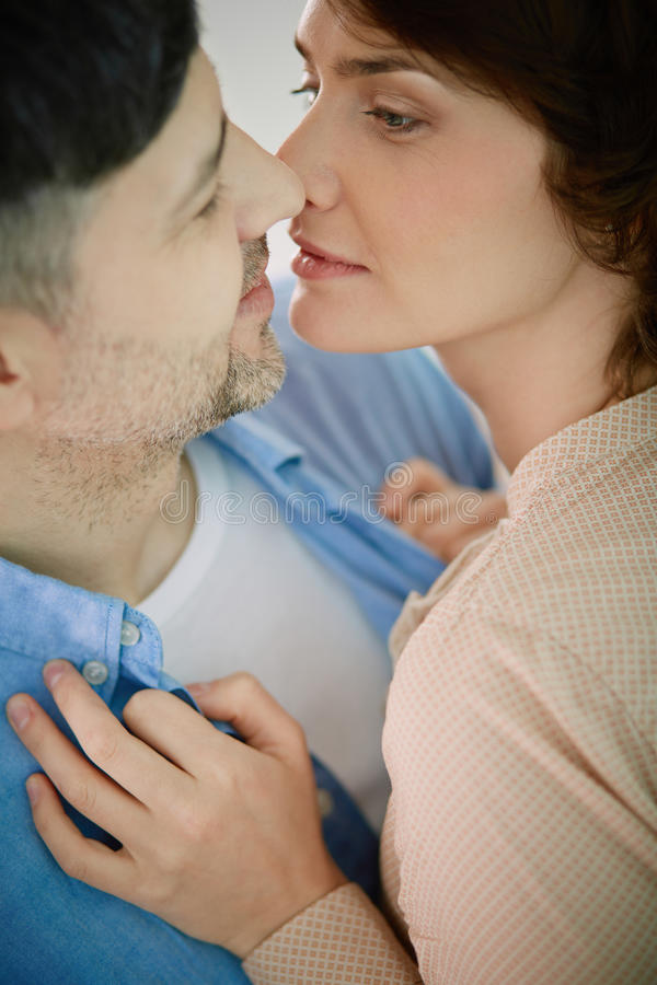 Romantic moment. Portrait of happy mature couple in embrace looking at one another royalty free stock photography