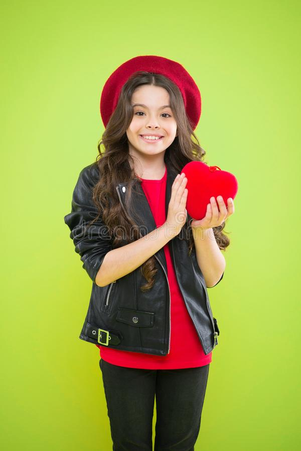Romantic mood. Celebrate valentines day. Love concept. Girl cute child show heart toy. Heart symbol of love. Kid stylish. Modern girl happy face show heart stock photo