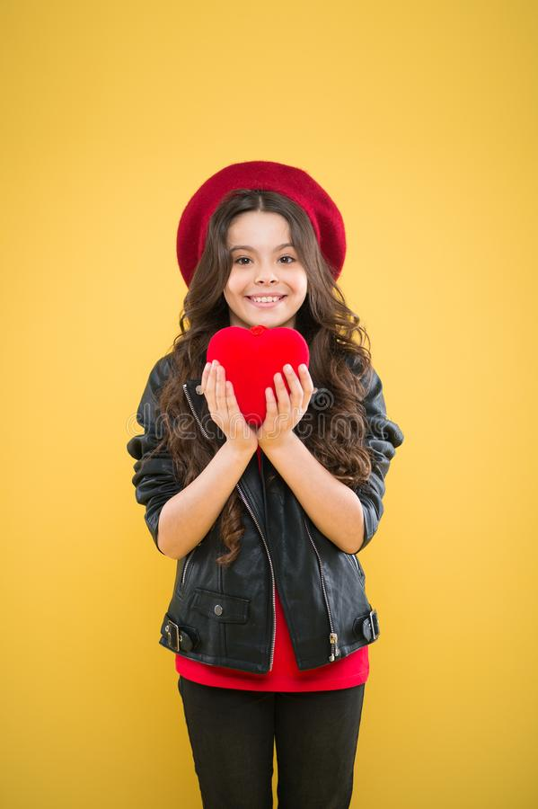 Romantic mood. Do not play with my heart. Celebrate valentines day. Love concept. Girl cute child show heart toy. Heart. Symbol of love. Kid stylish modern girl royalty free stock photography