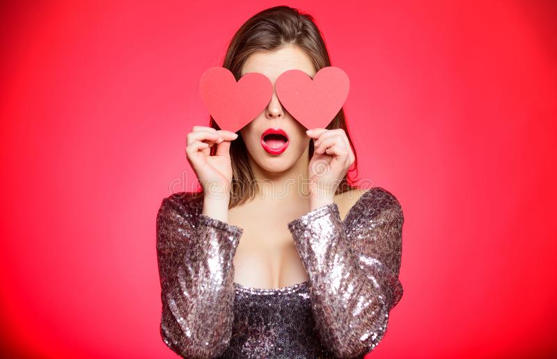 Romantic mood. Girl in love dating. Obsession concept. Fall in love. Girl adorable fashion model makeup face hold heart. Valentines card. Love from first sight stock photography