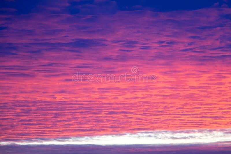 Romantic morning sky in bright and clear purple, pink, red and blue colors, winter sunrise, nature beauty color background stock images