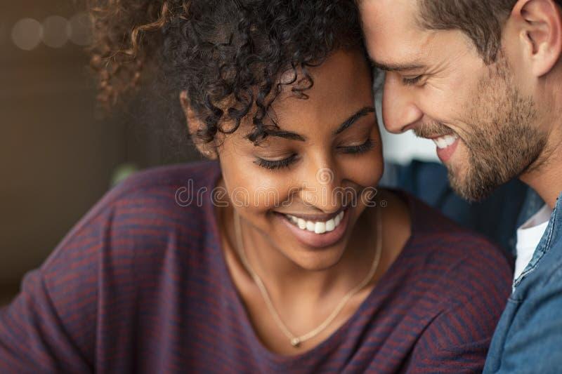 Romantic multiethnic couple in love stock image