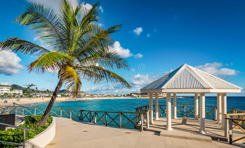Romantic pavilion and palm tree on St Maarten Island. stock photo