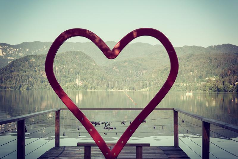 Romantic photo zone for wedding or love story in the shape of a heart on alpine lake Bled, Slovenia. Romantic photo zone for wedding or love story in the shape stock photos