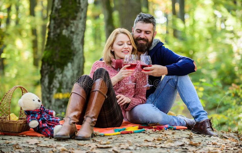 Romantic picnic with wine in forest. Couple in love celebrate anniversary picnic date. Couple cuddling drinking wine. Enjoying their perfect date. Happy loving stock photos