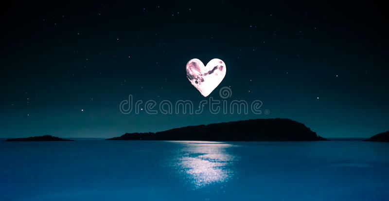 Romantic picture of a heart-shaped moon over a calm sea stock image