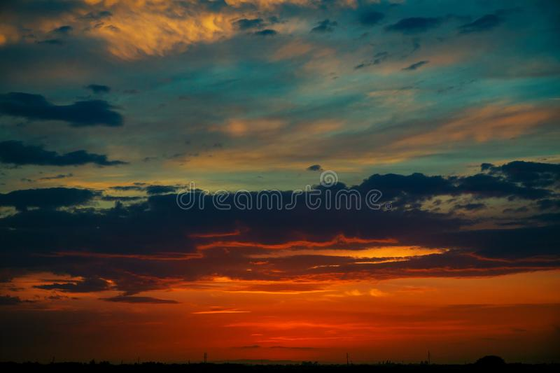 Romantic pink sunset sky, background. Sunset sunrise with clouds royalty free stock photo