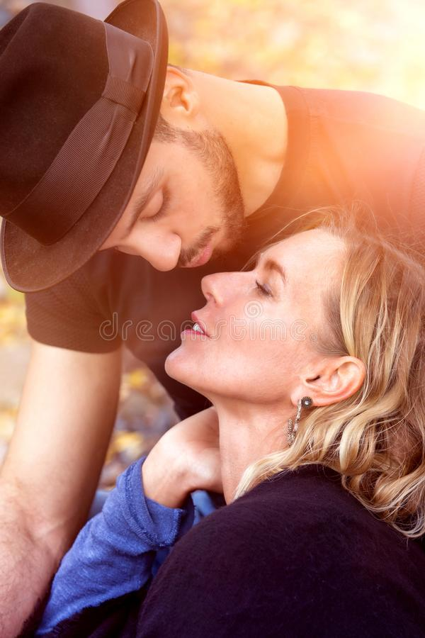 Romantic portrait of beautiful couple kissing stock image