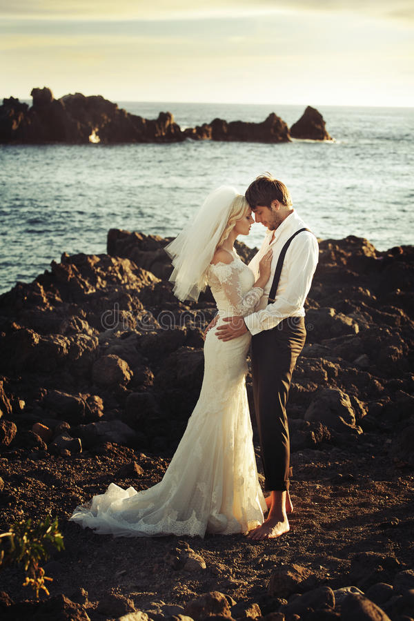 Romantic portrait of young newlyweds stock photos