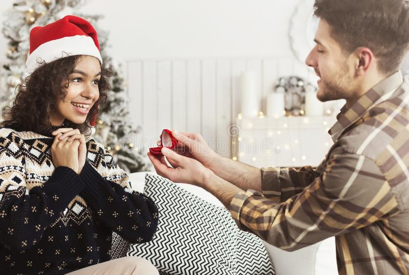 Romantic proposal on Christmas eve stock image