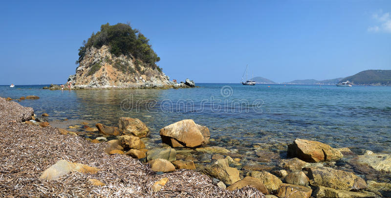 Romantic quiet beach with a small island on Elba island. royalty free stock image