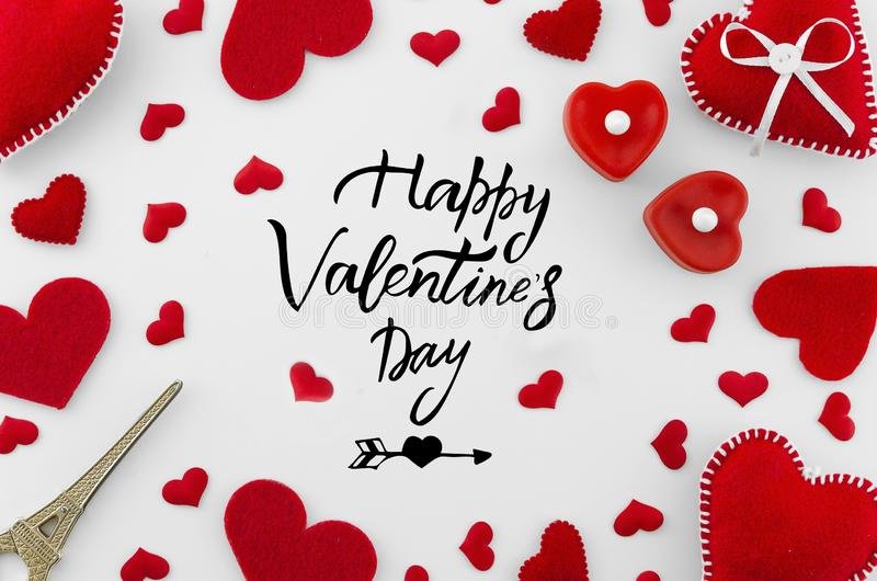 Romantic red flat lay composition on white background. Heart top view. Happy Valentines day hand lettering greeting card royalty free stock photography