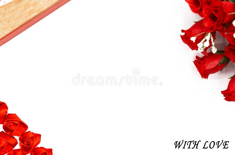 Romantic and red frame. Romantic frame with white background, a bouquet of red roses and several small roses of the same color, all made of cloth, to make royalty free stock photography