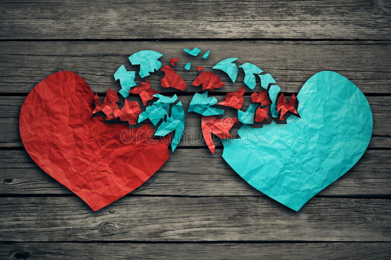 Romantic relationship concept two hearts exchange feelings. Romantic relationship concept as two hearts made of torn crumpled paper on weathered wood as symbol royalty free stock images