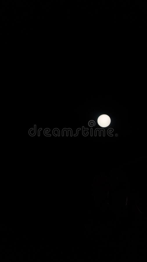 Romantic round full moon in summer. A very romantic round full moon in the summer nights in india royalty free stock photos