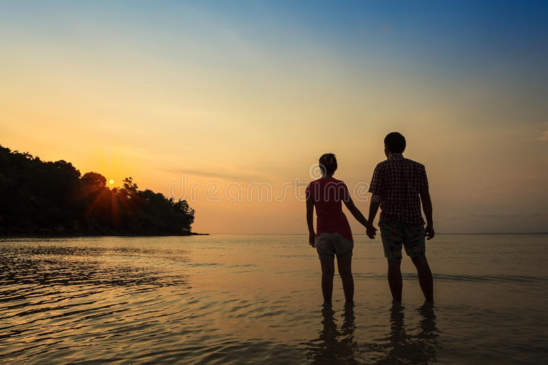 Love couple. Romantic scene of love couples at the sea stock images