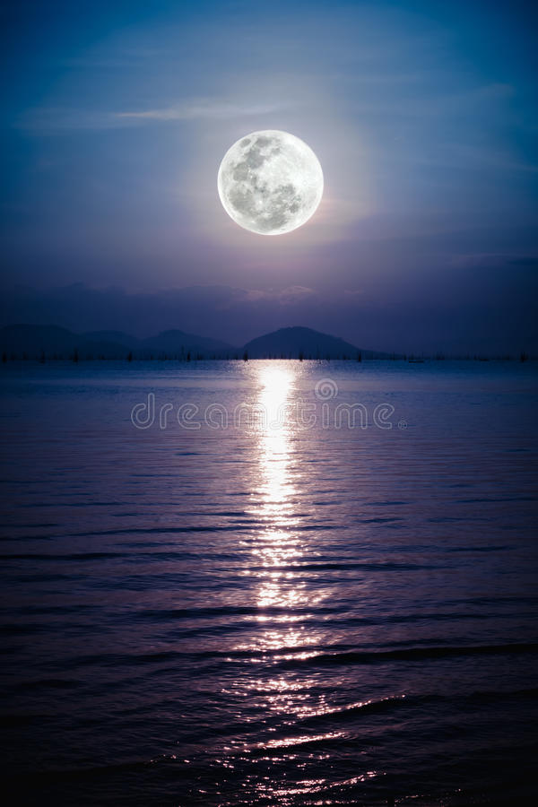 Romantic scenic with full moon on sea to night. Reflection of mo. Fantastic view of the sea. Romantic scenic with full moon on sea to night. Reflection of moon stock photo