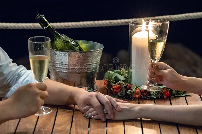Romantic screen in Wedding celebration bride and groom were holding hands together with champagne in the night royalty free stock image
