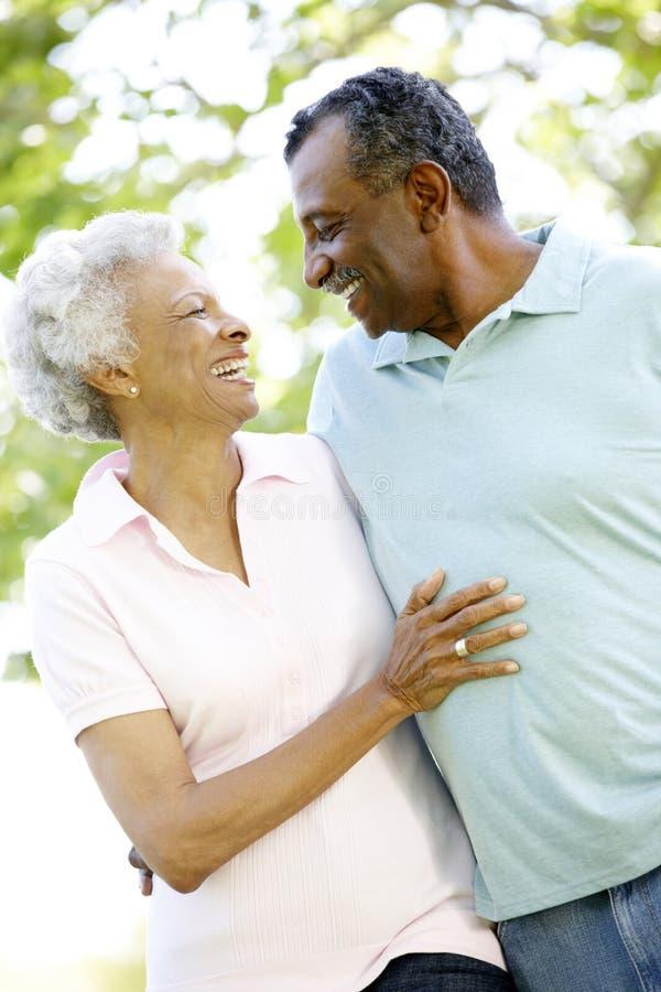 Romantic Senior African American Couple Walking In Park stock image
