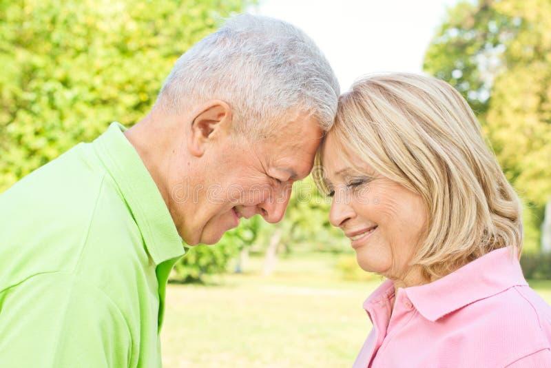 Romantic senior couple outdoors royalty free stock photo