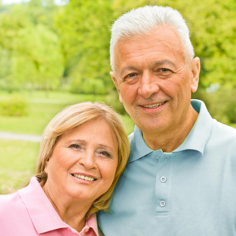 Romantic senior couple outdoors royalty free stock images