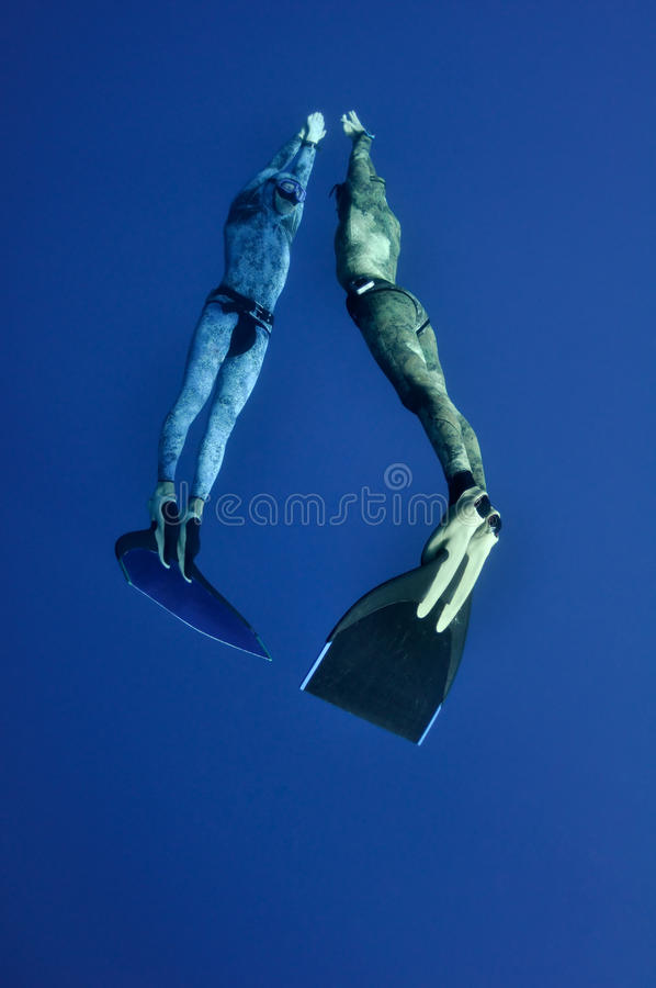 The Romantic Simultaneous Freedive Into The Depth Royalty Free Stock Photo